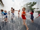 Children play in the fountains at the Southbank Centre, outside the Royal Festival Hall